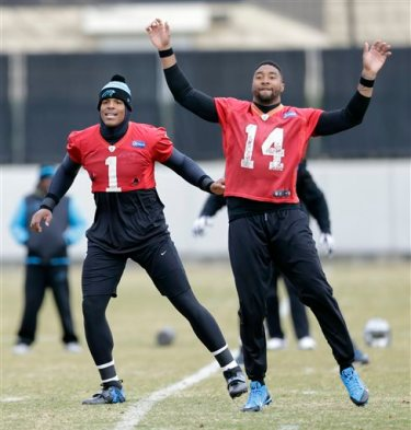Carolina Panthers quarterback Cam Newton (1) and Joe Webb (14) stretch with the team during an NFL football practice in Charlotte, N.C., Thursday, Dec. 18, 2014. (AP Photo/Chuck Burton)