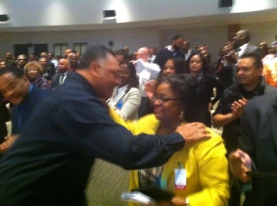 Jesse Jackson confers with Rainbow PUSH Coalition Vice President for Legal Affairs Janis L. Mathis at technology forum in Santa Clara, Calif. (Photo by Butch Wing)