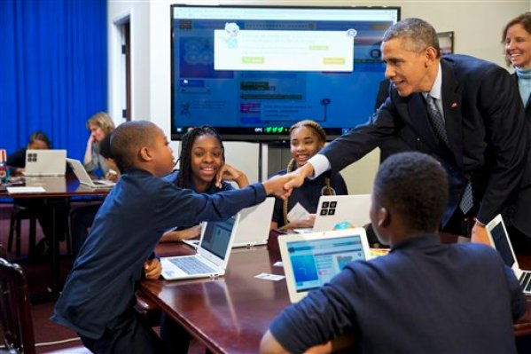 """President Barack Obama greets students during an """"Hour of Code"""" event in the Eisenhower Executive Office Building on the White House complex in Washington, Monday, Dec. 8, 2014, attended by middle-school students from Newark, N.J. (AP Photo/Jacquelyn Martin)"""