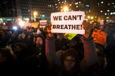 In this Dec. 4, 2014 file photo, demonstrators participate in a rally against a grand jury's decision not to indict the police officer involved in the death of Eric Garner, in New York. Who, if anyone, is leading the emerging movement around the deaths of Michael Brown and Eric Garner -- younger activists or legacy civil rights groups? The legacy civil rights organizations _ the National Action Network, the NAACP, the National Urban League _ last week called for people to coalesce on Saturday for a national march with the families of Michael Brown and Eric Garner, unarmed black men who have died at the hands of white police officers. Grand juries refused to indict the white police officers in those cases. (AP Photo/John Minchillo, File)