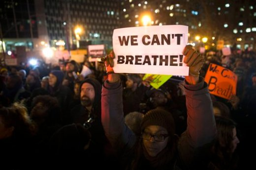 FILE - In this Dec. 4, 2014 file photo, demonstrators participate in a rally against a grand jury's decision not to indict the police officer involved in the death of Eric Garner, in New York. Who, if anyone, is leading the emerging movement around the deaths of Michael Brown and Eric Garner -- younger activists or legacy civil rights groups? The legacy civil rights organizations _ the National Action Network, the NAACP, the National Urban League _ last week called for people to coalesce on Saturday for a national march with the families of Michael Brown and Eric Garner, unarmed black men who have died at the hands of white police officers. Grand juries refused to indict the white police officers in those cases. (AP Photo/John Minchillo, File)
