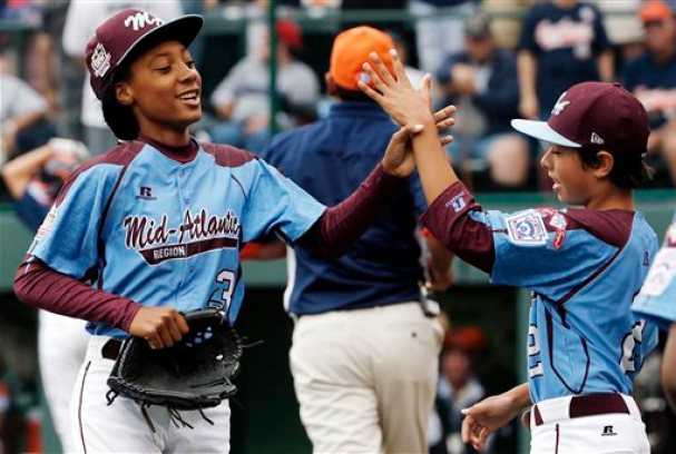 FILE - In this Aug. 15, 2014, file photo, Pennsylvania pitcher Mo'ne Davis, left, celebrates with teammate Jack Rice (2) after getting the final out of a 4-0 shutout against Tennessee during a baseball game in United States pool play at the Little League World Series tournament in South Williamsport, Pa. Davis has been named The Associated Press 2014 Female Athlete of the Year. At just 13, she is the youngest winner ever. (AP Photo/Gene J. Puskar, File)