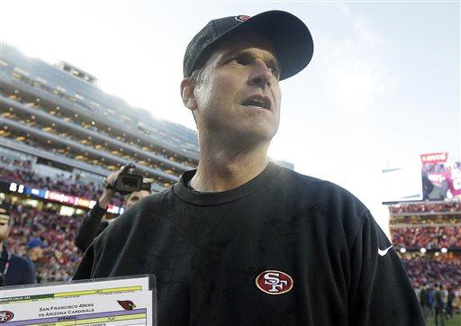 San Francisco 49ers head coach Jim Harbaugh walks off the field after an NFL football game against the Arizona Cardinals in Santa Clara, Calif., Sunday, Dec. 28, 2014. The 49ers won 20-17. (AP Photo/Marcio Jose Sanchez)