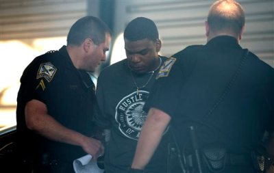 Markale Hart of Camp Hill, Ala., is taken into custody for the shooting death of Jakell Lenard Mitchell, an Auburn football player, on Sunday, Dec. 14, 2014, in Opelika, Ala. Police Capt. Will Matthews said in an emailed statement that Hart was being held at a county jail and no additional arrests were anticipated. (AP Photo/The Montgomery Advertiser, Albert Cesare)