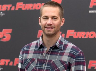 """In this April 29, 2011 file photo, actor Paul Walker poses during the photo call of the movie """"Fast and Furious 5,"""" in Rome. A man who stole part of the Porsche that Walker died in has been sentenced to six months in jail. City News Service says 26-year-old Anthony Janow was sentenced Tuesday, Dec. 9, 2014, in Southern California. (Photo/Andrew Medichini, File)"""