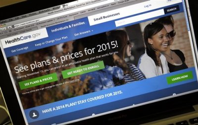 In his Nov. 12, 2014 file photo, the HealthCare.gov website, where people can buy health insurance, on a laptop screen, shown in Portland, Ore. Being uninsured in America will cost you more in 2015. In 2015, all taxpayers have to report to the Internal Revenue Service for the first time whether or not they had health insurance the previous year. Most will check a box. It's also when the IRS starts collecting fines from some uninsured people, and deciding if others qualify for exemptions.  (AP Photo/Don Ryan, File)