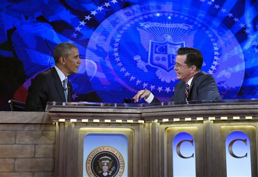 """FILE - This Dec. 8, 2014, file photo, shows President Barack Obama talking with Stephen Colbert of The Colbert Report during a taping of the program in Lisner Auditorium at George Washington University in Washington. It was supposed to be a joke. """"Are you still president?"""" comedian Stephen Colbert asked Barack Obama earlier this month. But the question seemed to speak to growing weariness with the president and skepticism that anything will change in Washington during his final two years in office. Democrats already are checking out Obama's potential successors. Emboldened Republicans are trying to push aside his agenda in favor of their own. (AP Photo/Susan Walsh, File)"""