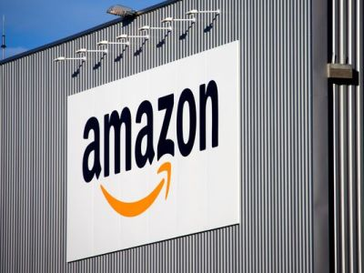 The Amazon logo is seen on the new logistics center of the online merchant in Lauwin-Planque, northern France. (Michel Spingler/AP Photo)