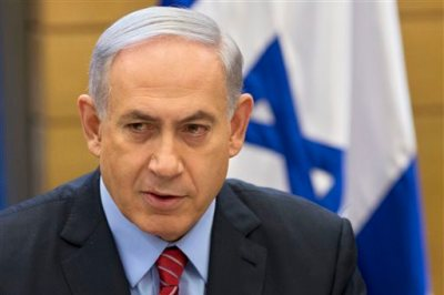 In this Dec. 3, 2014, file photo, Israeli Prime Minister Benjamin Netanyahu speaks during a faction meeting at the Knesset, Israel's parliament in Jerusalem. When Prime Minister Benjamin Netanyahu dissolved his unwieldy coalition and called new elections last month, he appeared to be a lock to return to office. But a new center-left alliance has suddenly surged in the polls past his ruling Likud party to become the largest parliamentary faction and turned the March 17 vote into a toss-up. (AP Photo/Sebastian Scheiner, File)
