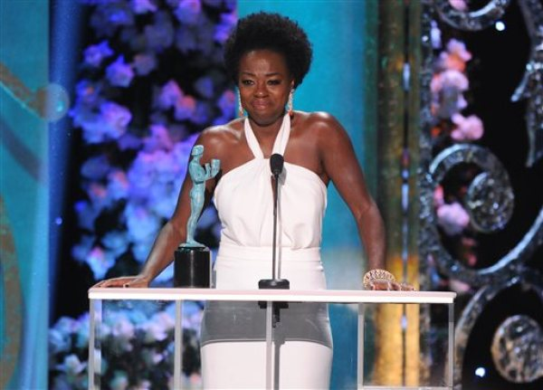 """Viola Davis accepts the award for outstanding performance by a female actor in a drama series for """"How to Get Away with Murder"""" on stage at the 21st annual Screen Actors Guild Awards at the Shrine Auditorium on Sunday, Jan. 25, 2015, in Los Angeles. (Photo by Vince Bucci/Invision/AP)"""
