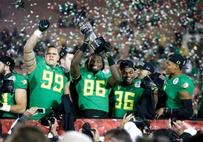Oregon players celebrate their win over Florida State at the Rose Bowl NCAA college football playoff semifinal, Thursday, Jan. 1, 2015, in Pasadena, Calif. (AP Photo/Lenny Ignelzi)