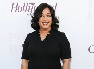 "In this Dec. 10, 2014, file photo, Shonda Rhimes arrives at the The Hollywood Reporter's Women In Entertainment Breakfast in Los Angeles. Rhimes is arguably the most powerful producer in television these days. ABC has turned over to her its entire Thursday night lineup, where she delivers weekly episodes of ""Grey's Anatomy,"" ""Scandal"" and ""How to Get Away With Murder."" (Photo by Richard Shotwell/Invision/AP, File)"
