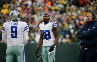 Dallas Cowboys wide receiver Dez Bryant (88) watches the scoreboard as officials review a catch by Bryant during the second half of an NFL divisional playoff football game Sunday, Jan. 11, 2015, in Green Bay, Wis. The call was reversed. (AP Photo/Nam Y. Huh)