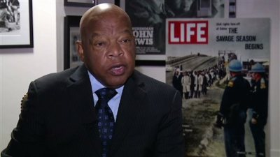 """In this Dec. 22, 2014 image taken from video, U.S. Rep. John Lewis, D-Ga., discusses the historical drama """"Selma"""" and civil rights in the United States during an interview in Atlanta. Forty-nine years after Lewis and other marchers tried to cross the Edmund Pettus Bridge in Selma, Ala., memories of """"Bloody Sunday"""" are still vivid in his mind. It was one of the defining moments of the civil rights era. (AP Photo/Alex Sanz)"""