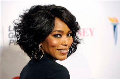 """Actress Angela Bassett, making her directorial debut with the Lifetime film """"Whitney,"""" turns back for photographers at the premiere of the film at the Paley Center for Media on Tuesday, Jan 6, 2015, in Beverly Hills, Calif. (Photo by Chris Pizzello/Invision/AP)"""