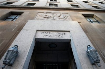 The Federal Trade Commission building in Washington on Wednesday, Jan. 28, 2015. The nation's largest prepaid mobile provider, TracFone Wireless, will pay $40 million to settle government claims that it misled millions of smartphone customers with promises of unlimited data service. The FTC said that TracFone's advertising promised unlimited data, but the company then drastically slowed down consumers' data speeds, a practice known as throttling, when they had used a certain amount of data within a 30-day period. In some cases, the FTC said, the company cut off customers' data service when they ran over the limit. (AP Photo/Alex Brandon)