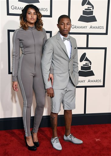 Helen Lasichanh, left, and Pharrell Williams arrive at the 57th annual Grammy Awards at the Staples Center on Sunday, Feb. 8, 2015, in Los Angeles. (Photo by Jordan Strauss/Invision/AP)