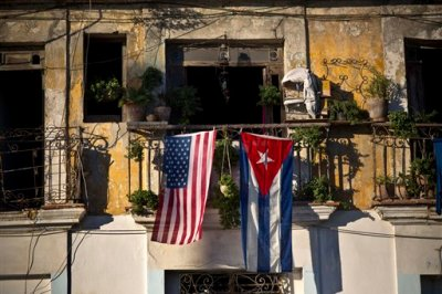 "In this Dec. 19, 2014 file photo, a U.S. and Cuban flag hang from a balcony in Old Havana, Cuba. As the two countries to end a half-century of acrimony, President Barack Obama has made clear that he is moving quickly to take Cuba off the list of state sponsors of terror, saying in a televised address on his new Cuba policy in late 2014 that ""at a time when we are focused on threats from al Qaeda to ISIL, a nation that meets our conditions and renounces the use of terrorism should not face this sanction."" (AP Photo/Ramon Espinosa, File)"