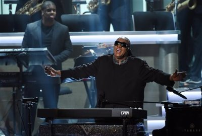 "Stevie Wonder takes in applause from the stage during the finale of ""Stevie Wonder: Songs in the Key of Life - An All-Star Grammy Salute,"" at the Nokia Theatre L.A. Live on Tuesday, Feb. 10, 2015, in Los Angeles. (Photo by Chris Pizzello/Invision/AP)"