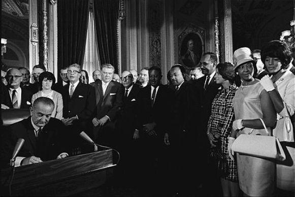 President Lyndon B. Johnson signs the Voting Rights Act of 1965 into law. (Yoichi R. Okamoto)