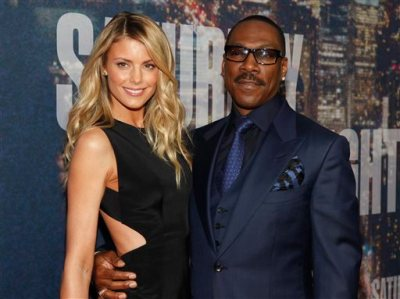 Paige Butcher, left, and Eddie Murphy attend the SNL 40th Anniversary Special at Rockefeller Plaza on Sunday, Feb. 15, 2015, in New York. (Photo by Andy Kropa/Invision/AP)