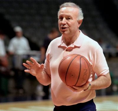 FILE - In this Oct. 17, 1995 file photo, Illinois men's basketball coach Lou Henson gives directions to his team during practice after the team's media day in Champaign, Ill. The team started practice this week at the Assembly Hall in Champaign, Ill. On Tuesday, Feb. 17, 2015, Henson learned he was headed for the College Basketball Hall of Fame. (AP Photo/Mark Cowan, File)