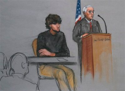 In this Jan. 5, 2015, file courtroom sketch, Boston Marathon bombing suspect Dzhokhar Tsarnaev, left, is depicted beside U.S. District Judge George O'Toole Jr., right, as O'Toole addresses a pool of potential jurors in a jury assembly room at the federal courthouse, in Boston.   Lawyers for Boston Marathon bombing suspect Tsarnaev have asked a judge three times to move his trial out of Massachusetts because of the emotional impact of the deadly attack. Three times, the judge has refused. On Thursday, Feb. 19, Tsarnaev's defense team will ask a federal appeals court to take the decision out of the hands of O'Toole Jr. and order him to move the trial. They insist that Tsarnaev cannot find a fair and impartial jury in Massachusetts because too many people believe he's guilty and many have personal connections to the marathon or the bombings. (AP Photo/Jane Flavell Collins, File)