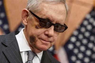 """Senate Minority Leader Harry Reid of Nev. pauses during a news conference on Capitol Hill, Tuesday, Feb. 24, 2015, to urge Republicans to support a """"clean bill"""" to fund the Homeland Security Department as that agencies budget expires later this week. The DHS budget is at a standstill over provisions attached to a Homeland Security spending bill aimed at blocking President Barack Obama's executive actions on immigration. (AP Photo/J. Scott Applewhite)"""