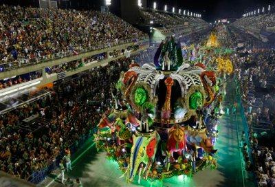 Performers from the Imperatriz Leopoldinense samba school parade during carnival celebrations at the Sambadrome in Rio de Janeiro, Brazil, Tuesday, Feb. 17, 2015. (AP Photo/Leo Correa)
