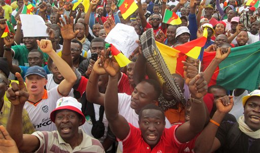 Cameroonian people gather to protest against Islamic extremists attacks in Yaounde, Cameroon, Saturday, Feb. 28, 2015.  Some thousands of Cameroonian youths say they marched through the capital to show support for the military's battle against Nigeria's Islamic extremists in the country's north.  (AP Photo/Edwin Kindzeka Moki)