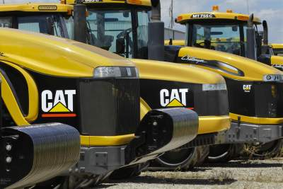 This file photo shows Caterpillar logos on earth moving tractors and equipment in Clinton, Ill. on June 20, 2012. (AP Photo)