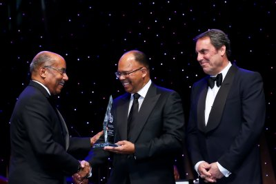 General Motors Vice President Global Design Ed Welburn (left) receives the 2015 Black Engineer of the Year award from GM Board of Directors member Errol Davis (center) and GM Executive Vice President Global Product Development Mark Reuss at the BEYA STEM Conference Black Engineer of the Year Gala, Saturday, February 7, 2015 in Washington, DC. (Photo by Tony Powell for General Motors)