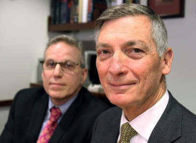 This Friday, Feb. 6, 2015 photo shows stroke survivor Don Sadoway, foreground, and Lee Schwamm, vice chairman of the Massachusetts General Hospital's neurology department, in Boston. When medicine failed to dissolve a clot in Sadoway's brain, his wife agreed to let doctors try a new type of stent, and it worked. (AP Photo/Rodrique Ngowi)
