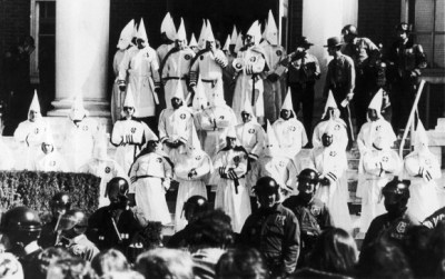 Well guarded by state and local police, members of the Ku Klux Klan held a rally on the steps of City Hall in Meriden, Connecticut, Saturday, March 20, 1982. The rally was peaceful, but Klan head Bill Wilkinson's speech was drowned out by the crowd. (AP Photo/Bob Child)