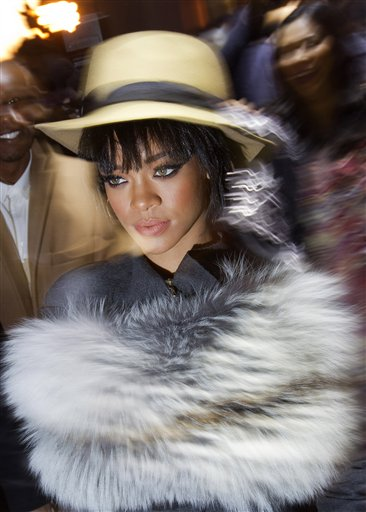 FILE - This Feb. 27, 2014 file photo shows Rihanna arriving for the Lanvin ready-to-wear fall/winter 2014-2015 fashion collection in Paris. Singer Rihanna has a new gig: representing Christian Dior. The storied French fashion house said Friday that she will appear in an upcoming video and print ad campaign filmed in Versailles and slated to run this spring. (AP Photo/Jacques Brinon, File)