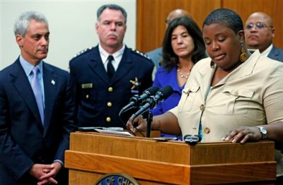 In this Oct. 15, 2013 file photo, Cleopatra Pendleton, the mother of slain teen Hayida Pendelton, speaks at a news conference about gun violence in Chicago. Looking on from left are Chicago Mayor Rahm Emanuel, Police Superintendent Garry McCarthy and Cook County State's Attorney Anita Alvarez. Fifteen-year-old Hadiya Pendleton was shot and killed Jan. 29, 2013 in a park during a gang dispute she had nothing to do with. Mayor Emanuel has spent nearly $200 million over the last two years to flood the city's streets with police working overtime to help quell the violence. Since then, overall violence has declined, but the number of slayings in some minority neighborhoods actually jumped. Emanuel is facing opponent Cook County Commissioner Jesus Garcia in a April 7, 2015 runoff election. (AP Photo/M. Spencer Green, File)