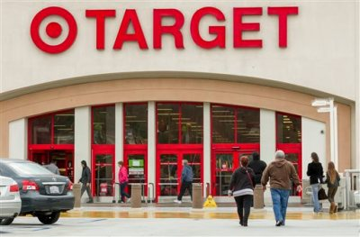 In this Dec. 19, 2013, file photo, shoppers arrive at a Target store in Los Angeles. Target has proposed to pay $10 million to settle a class-action lawsuit brought against it following a massive data breach in 2013. (AP Photo/Damian Dovarganes, File)