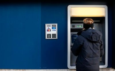 In this Jan. 5, 2013 file photo, a woman uses an ATM machine in downtown Pittsburgh. The Federal Reserve reports on household wealth for the October-December quarter of 2014 on Thursday, March 12, 2015. (AP Photo/Gene J. Puskar, File)