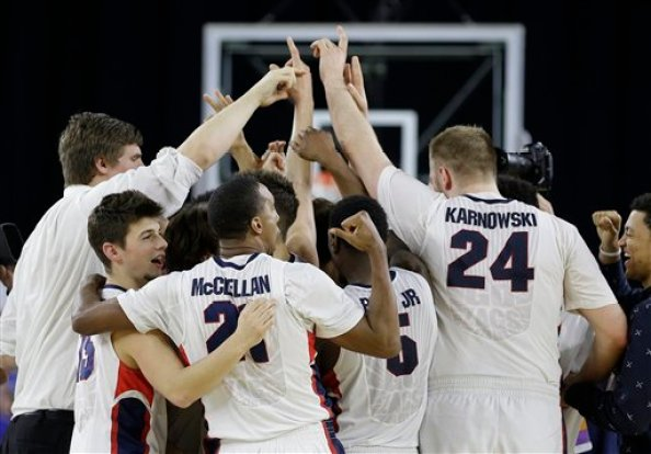 Gonzaga players celebrate after the second half of a college basketball regional semifinal game in the NCAA Tournament against UCLA, Friday, March 27, 2015, in Houston. Gonzaga won 74-62. (AP Photo/David J. Phillip)
