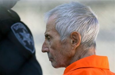 In this Tuesday, March 17, 2015, file photo, Robert Durst is escorted into Orleans Parish Prison after his arraignment in Orleans Parish Criminal District Court in New Orleans. The whispered words of Durst recorded in an unguarded moment in a bathroom could come back to haunt him - or help him - as he faces a murder charge. A possible move by prosecutors to introduce the incriminating material from a six-part documentary on his strange life and connection to three killings could back fire as interview footage did in the Michael Jackson molestation trial and the Robert Blake murder case.  (AP Photo/Gerald Herbert, File)