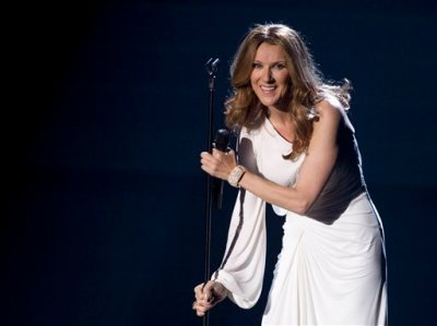 In this March 15, 2011 file photo, Celine Dion reacts to the audience during her opening night performance at Caesar's Palace, in Las Vegas. A representative for Dion says the performer will return to the stage but offered no dates for future performances. Dion hasn't performed since her July 29, 2014 show at The Colosseum at Caesars Palace in Las Vegas. (AP Photo/Julie Jacobson, File)