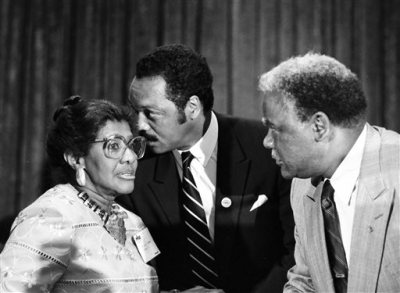 In this Aug. 3, 1986 photo, the Rev. Willie T. Barrow, left, confers with Jesse Jackson Jr., center, and Chicago Mayor Harold Washington during the Operation Push convention in Chicago. Barrow, a longtime civil right activist, died Thursday, March 12, 2015, at a hospital where she was being treated for a blood clot in her lung. She was 90. (AP Photo/Sun-Times Media)
