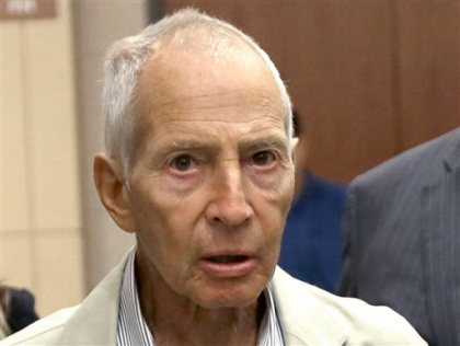 In this Aug. 15, 2014 file photo, New York City real estate heir Robert Durst leaves a Houston courtroom. Durst was arrested in New Orleans on an extradition warrant to Los Angeles on Saturday, March 14, 2015. (AP Photo/Pat Sullivan, File)