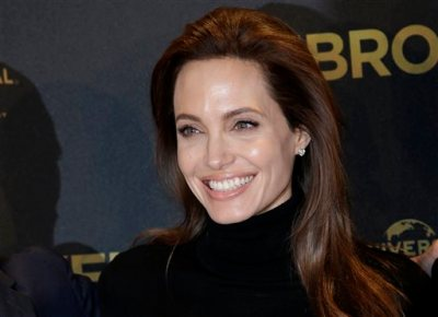 "In this Nov. 27, 2014 file photo, director Angelina Jolie poses for photographers during a photo call for her film ""Unbroken"" in Berlin, Germany. Jolie announced in an op-ed in The New York Times on Tuesday, March 24, 2015, that she had her ovaries and fallopian tubes removed to prevent cancer. (AP Photo/Michael Sohn, File)"