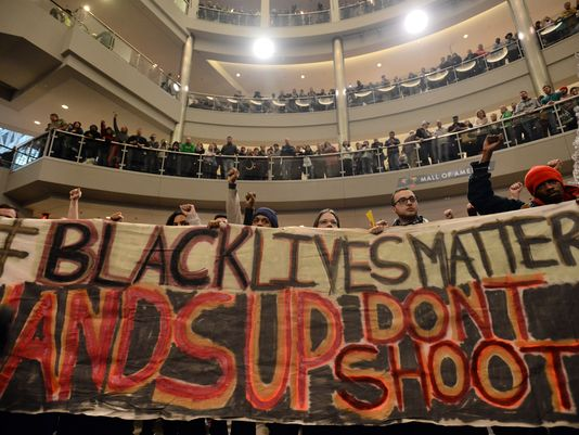 "Demonstrators filled the Mall of America rotunda and chanted ""black lives matter"" to protest police brutality, Saturday, Dec. 12, 2014, in Bloomington, Minnesota. In Wausau, church leaders are planning a Black Lives Matter march which they've also called a march to ""stand against racism."" (Photo: AP Photo/The Star Tribune, Aaron Lavinsky)"