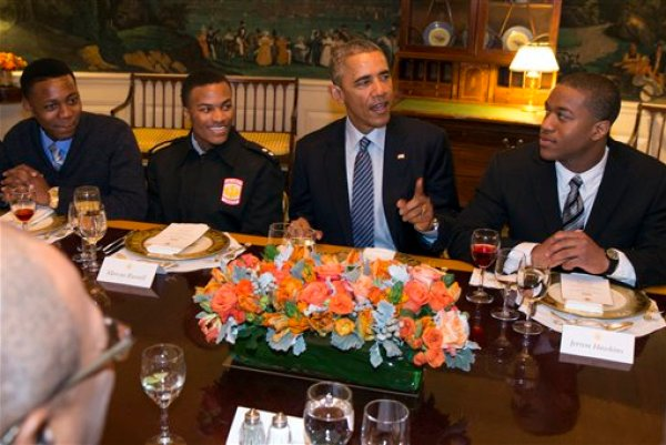"""In this Feb. 27, 2015, photo,. President Barack Obama hosts a lunch with """"My Brother's Keeper"""" mentees in the Map Room of the White House in Washington. Even more money than expected has been committed to Obama's initiative aimed at helping young men of color, White House officials said Thursday, March 5. One year after the program began, more than $300 million in grants and in-kind resources have been independently committed to Obama's """"My Brother's Keeper"""" initiative, said Broderick Johnson, chair of the My Brother's Keeper task force. (AP Photo/Evan Vucci)"""