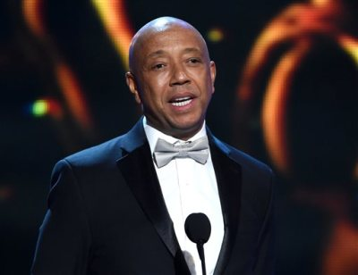 "In this Feb. 6, 2015 file photo, Russell Simmons presents the Vanguard Award on stage at the 46th NAACP Image Awards in Pasadena, Calif.  Simmons is producing a brand new stage musical that will celebrate three generations of hip-hop, from Run DMC to Kanye West. Simmons  said Thursday, March 19, 2015, that ""The Scenario"" will feature an original story written by author and hip-hop historian Dan Charnas and aims to premiere in New York City in late 2016. (Photo by Chris Pizzello/Invision/AP, File)"