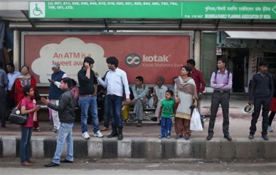 """Indians wait for a bus at the bus stop where the victim of a deadly gang rape had boarded on Dec. 16, 2012, in New Delhi, India, Wednesday, March 4, 2015. When one of the four men sentenced to death for the high-profile gang rape of the woman in 2012 was quoted in a new documentary as saying """"a girl is far more responsible for rape than a boy,"""" he was repeating something community and religious leaders in this nation of 1.2 billion routinely say. Mukesh Singh, who was driving the bus for much of the time that the 23-year-old woman was being attacked, told the documentary film maker that the victim should have remained silent and allowed the rape, and that they would have spared her life. (AP Photo/Altaf Qadri)"""