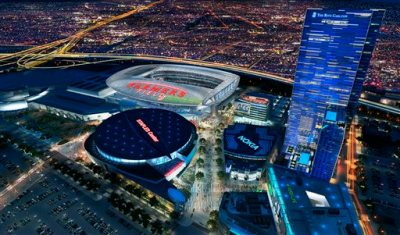 """This undated file artist's rendering provided by AEG shows a proposed NFL football stadium, to be named Farmers Field in Los Angeles. A transportation consultant said Monday, Sept. 26, 2011, the $1.2 billion football stadium proposed for downtown Los Angeles. Developer AEG said in a statement Monday, March 9, 2015, that it is """"no longer in discussion with the NFL or any NFL team."""" The announcement leaves two clear contenders for the NFL's return to the area, both in cities just outside Los Angeles: A stadium in Inglewood proposed in January with the backing of St. Louis Rams owner Stan Kroenke, and a project in Carson announced last month with the joint backing of the Oakland Raiders and San Diego Chargers. (AP Photo/AEG, File)"""