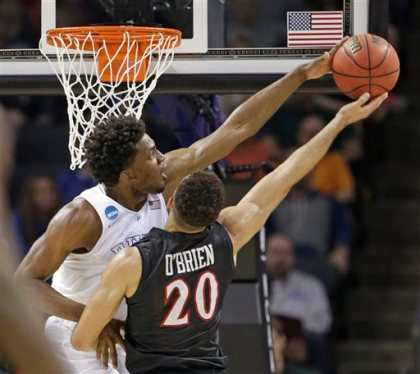 Duke's Justise Winslow, left, blocks a shot by San Diego State's J.J. O'Brien (20) during the first half of an NCAA tournament college basketball game in the Round of 32 in Charlotte, N.C., Sunday, March 22, 2015. (AP Photo/Gerald Herbert)